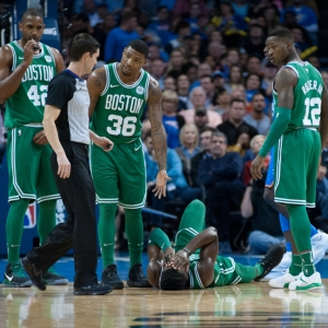 Boston Celtics Guard Marcus Smart (36) looks to the pleads the case to the ref of why Boston Celtics Forward Jaylen Brown (7) is laying on the court hurt versus Oklahoma City Thunder