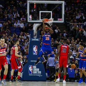 Mitchell Robinson of the New York Knicks scores two points from a slam dunk.