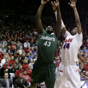 Shamari Spears (43) of Charlotte goes up strong against Josh Benson (44) of Dayton.