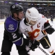 Flames Jarome Iginla (12) and Kings Matt Greene (2)
