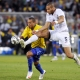 Oguchi Onyewu (white) and Luis Fabiano (yellow) battle for a loose ball.